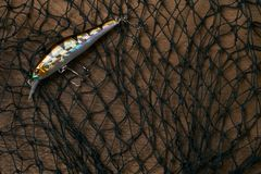 Fishing lure and fishnet royalty free stock image