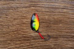 Fishing lure on the old wooden table. Macro photo Royalty Free Stock Photography