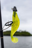 Fishing lure. This is a softbait an unbranded typical fishing lure. The color is chartreuse. It can be used for pike but also tarpon, snook and various species stock photo