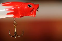 Fishing Lure (Wobbler Popper). A fishing lure (wobbler popper) with a hook Stock Image