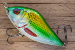 Fishing lure on Wooden Deck. One Fishing lure on Wooden Deck background.Close-Up royalty free stock image