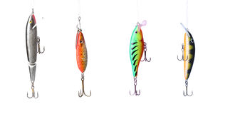 Fishing lures. Floating wobblers hanging in front of white background Stock Images