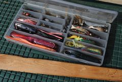 Fishing lures. A tackle box of fishing lures Stock Image