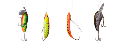 Fishing lures. Floating wobblers hanging in front of white background Stock Photography