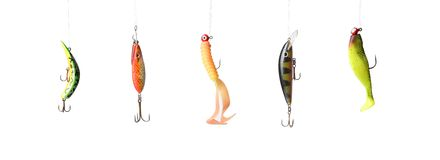 Fishing lures. Five fishing lures -floating wobblers hanging in front of white background Royalty Free Stock Photo