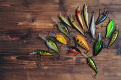 Fishing lures on a wooden background stock photo