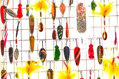 Fishing Lures. A collection of many different fishing lures hanging up.  Very colorful Royalty Free Stock Images