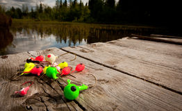Fishing Lures on the Dock. Assorted fishing lures ready for use on dock Stock Photos