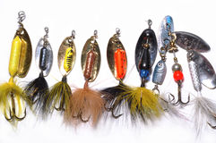 Fishing lures in a line on whi. Collection of Fishing lures in a line and on a white background Royalty Free Stock Photos