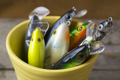 Fishing lures in a mug Stock Photo