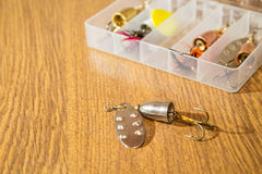 Fishing lures on old wooden table stock images
