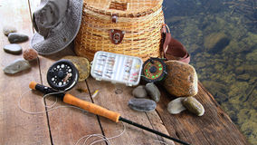 Fishing lures,reel,and sun hat Royalty Free Stock Image