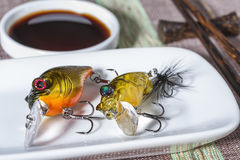 Fishing lures served on plate as a meal Stock Photography