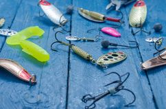 Fishing lures for spinning. Water drops. Tee, lure, soft bait, wobblers, hard bait. Royalty Free Stock Photo