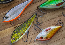 Fishing lures on wood Royalty Free Stock Photography