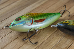 Fishing lures on wood Royalty Free Stock Image