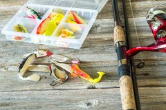 Fishing lures. At wooden background Royalty Free Stock Image
