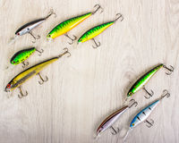 Fishing lures on a wooden background royalty free stock photos