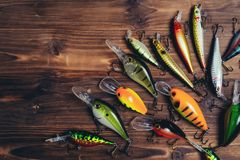 Fishing lures on a wooden background royalty free stock images