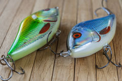 Fishing lures on wooden desk Stock Images