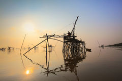 Fishing. Man and antique fishing equipment in the lake Royalty Free Stock Image