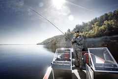 Fishing man in boat Royalty Free Stock Images