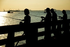 Fishing man silhouette Royalty Free Stock Photography
