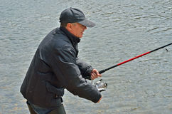 Fishing 24. A man with spinning rod on fishing Royalty Free Stock Photography