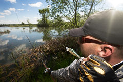 Fishing man. In sunny day Royalty Free Stock Photo