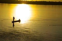 Fishing man and sunrise Royalty Free Stock Image