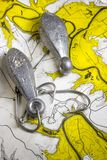 Fishing map. Fishing hooks sinkers and map Stock Photography
