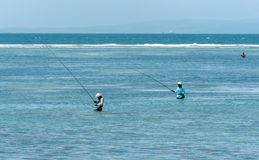 Fishing men in Bali Indonesia stock images
