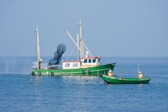 Fishing men at work at the Dutch sea Royalty Free Stock Image