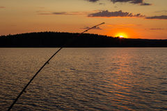 Fishing and midnight sun Stock Images
