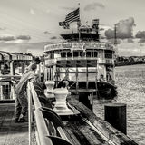 Fishing in the Mississippi River behind the Steamer Natchez Royalty Free Stock Image