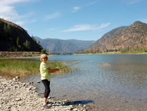 Fishing in Montana,USA. Woman fishing in one of the amazing region of Montana state Royalty Free Stock Photos