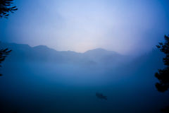 Fishing in morning of fog. Fishing in fog and Lake  in the morning Royalty Free Stock Photography