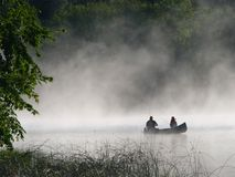 Fishing in the morning fog Royalty Free Stock Images