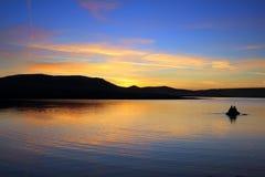 Fishing on morning lake Royalty Free Stock Photo