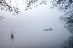 Fishing in the morning mist. Stock Images