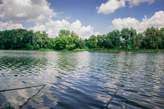 Fishing in the morning on the pond. Vacation, outdoor recreation. Stock Photography