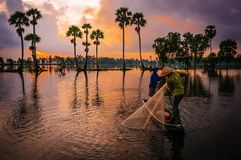 Fishing in the morning by two farmers royalty free stock photography