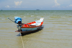 Fishing motorboat. On the beach stock photography