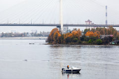 Fishing from the motorboat on Neva river in St. Petersburg city, suburbans. Russia Royalty Free Stock Photos