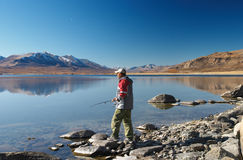 Fishing on mountain lake. Western Mongolia Royalty Free Stock Photography