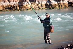 Fishing on mountain river Royalty Free Stock Photo