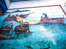 Fishing mural in the main street in the coastal city of Amalfi in Italy Royalty Free Stock Photography