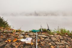 Fishing in the mysterious fog Stock Photos