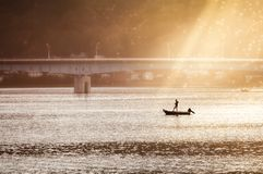 Fishing n the morning at Lake Kawaguchi, Japan. Going fishing under the bridge in the morning sun at Lake Kawaguchi, one of the scenic Fuji Five Lakes at royalty free stock photo