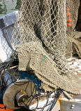 Fishing net. A fishing net with float and rope, equipment of a fisherman Royalty Free Stock Photo